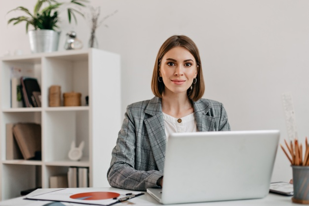 Virtual Assistant woman in front of her computer